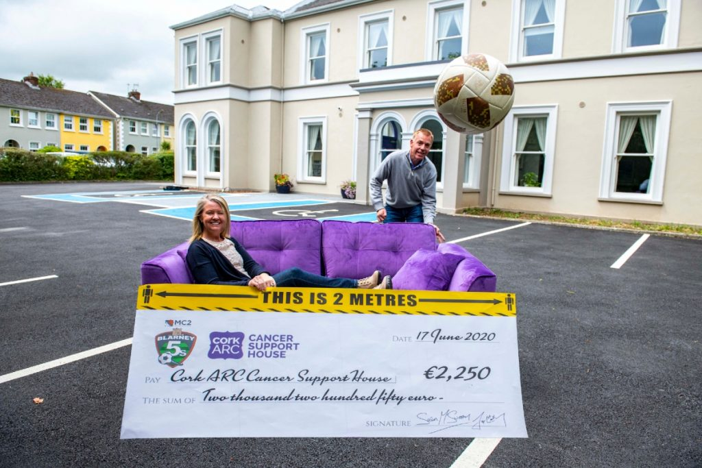 Sean McSweeney, partner at MC2, presents a cheque for €2,250 to Aileen O'Neill, CEO of Cork ARC in front of the newly refurbished Sarsfield House in Wilton.